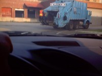 Laborer on outside of truck.